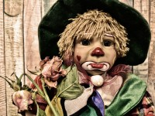 Собирать пазл Грустный клоун онлайн