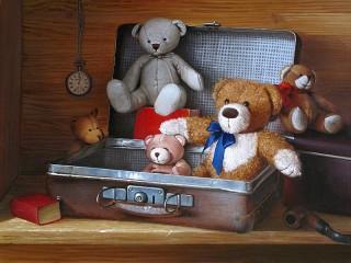 Собирать пазл Мишки в чемодане онлайн