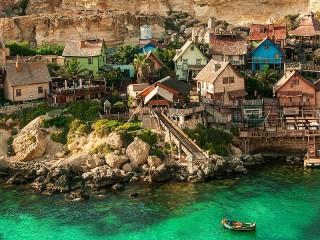 Собирать пазл Поселение на Мальте онлайн