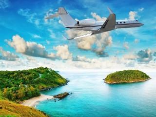 Собирать пазл Самолет над островом онлайн