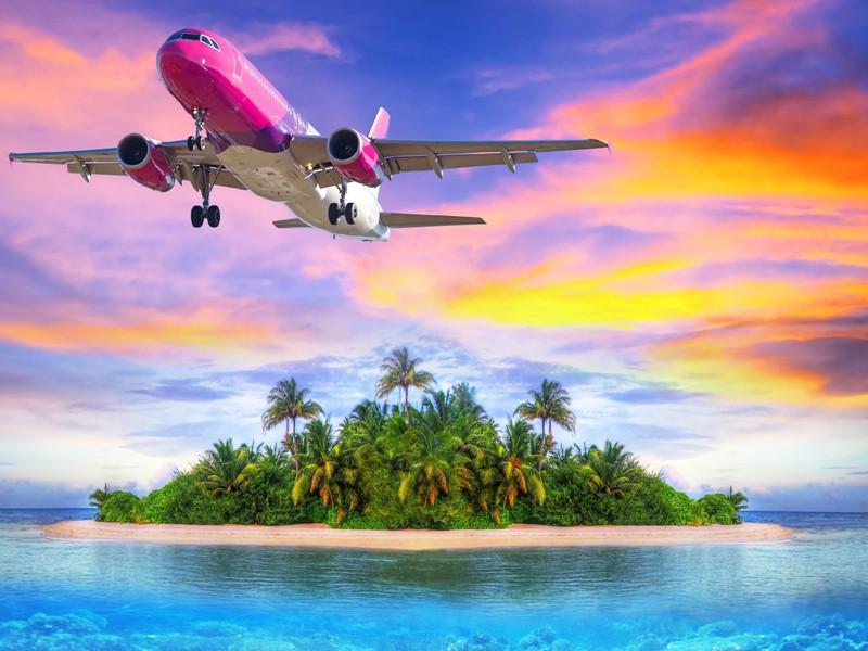 Пазл Собирать пазлы онлайн - Самолёт над островом