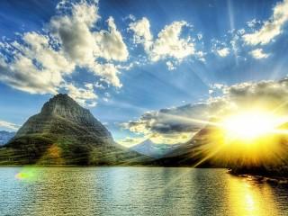Собирать пазл Солнце горы и вода онлайн