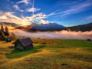 Собирать пазл Солнце за горами онлайн