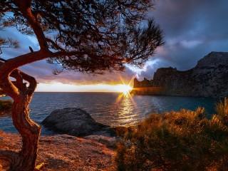 Собирать пазл Закат на море онлайн