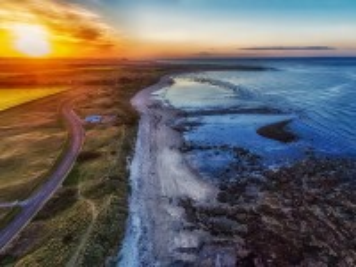 Собирать пазл Закат на побережье онлайн