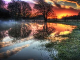 Собирать пазл Закат над болотом онлайн